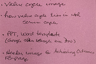 A pink notecard with black cursive text reads with four bullet points (as outlined below the image next).